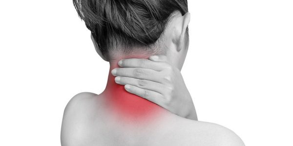 woman suffering from neck pain using hand massage painful neck and nape. mono tone color with red highlight at neck , neck muscles isolated on white background. health care ,medical concept. studio